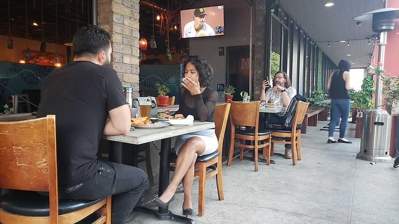 Patrons dining outside at Common Theory in the Kearny Mesa neighborhood of Sa...