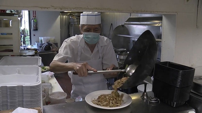 The chef of Hunan Chinese Restaurant working in the restaruant's kitchen in R...