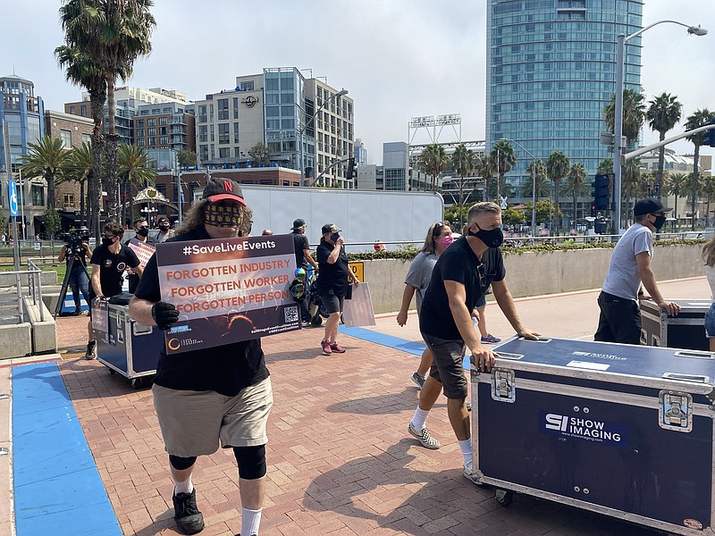 San Diego Events Coalition and industry workers march from Waterfront Park to...