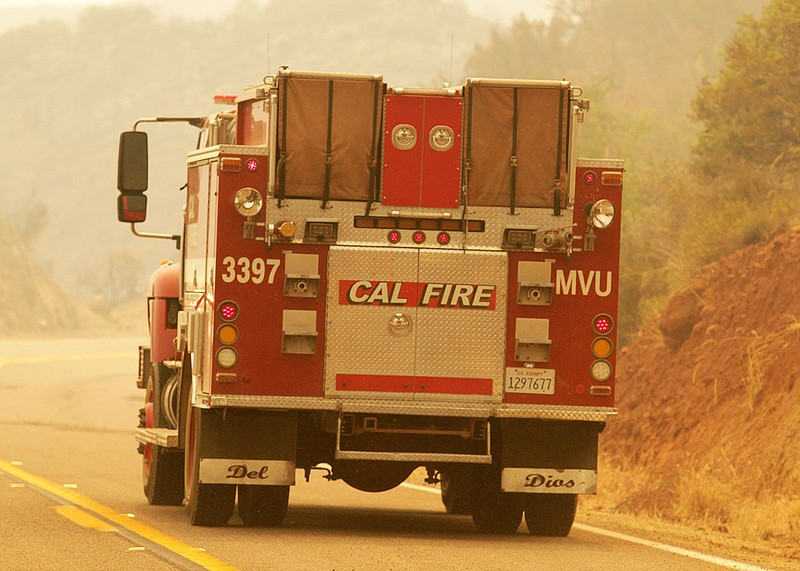 A Cal Fire truck drives drives down a road during the Valley Fire, Sept. 7, 2...