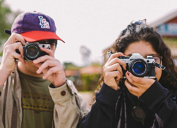 Youth photographers involved with Outside the Lens progra...