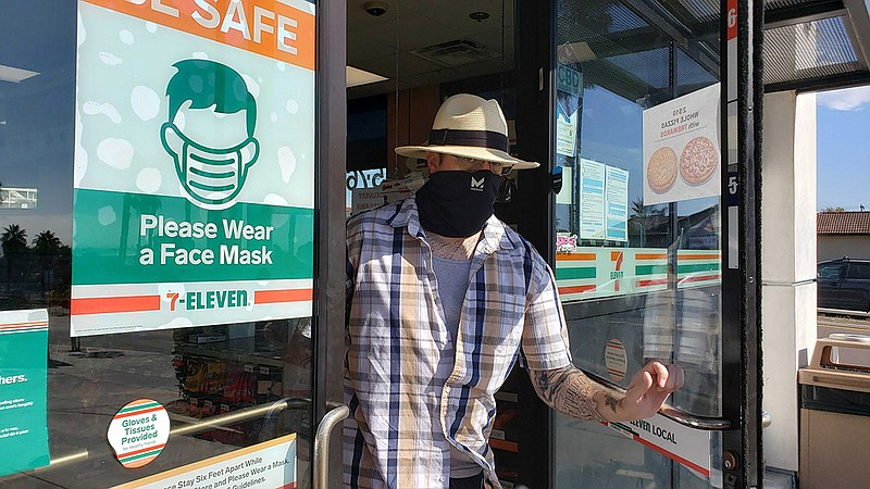 Man walking out of 7-Eleven in Bay Park on Aug. 1, 2020. The business, like m...