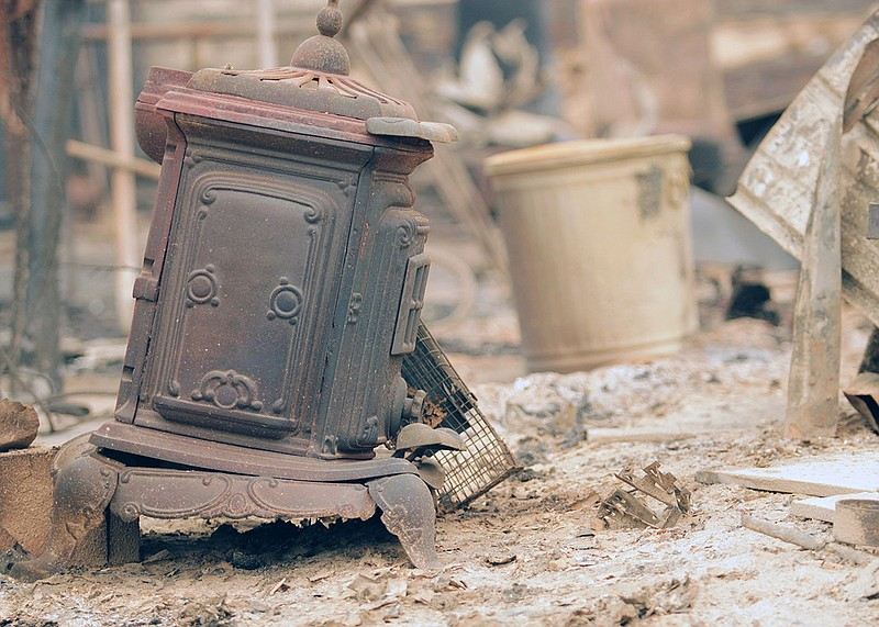 The charred remnants of a home near Jamul burned in the Valley Fire in this p...