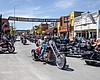 Bikers ride down Main Street during the 80th an...