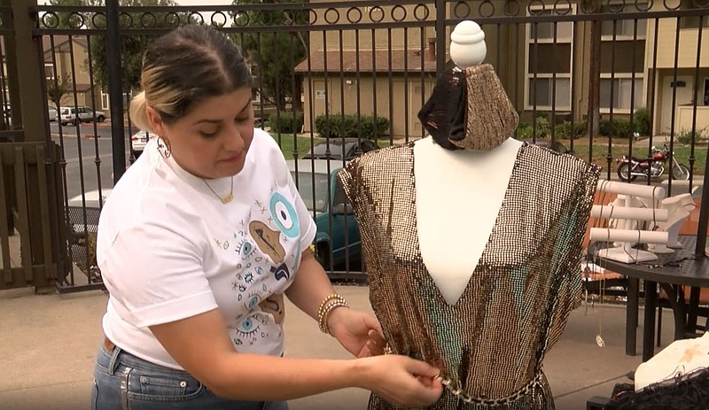 May Hasan shows off her Iraqi-inspired designs in El Cajon, on September 11th...