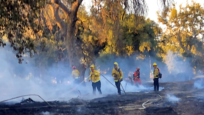 Firefighters mopping up hot spots Sept. 10, 2020, at the Valley Fire.