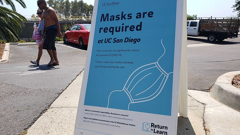 A sign advising of coronavirus precautions on the campus of Scripps Instituti...