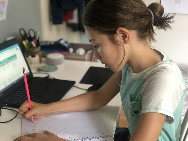 Edie Evans, a fifth-grader at San Diego Unified, working on her assignment wh...