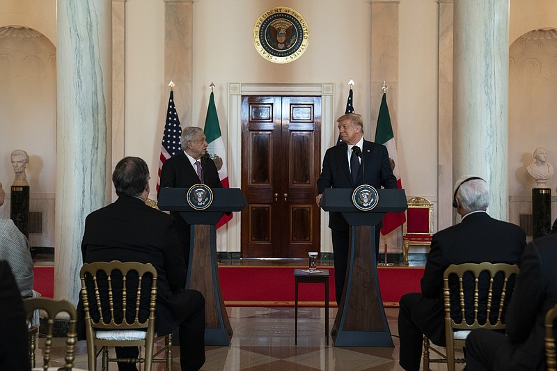 President Donald Trump listens as Mexican President Andres Manuel Lopez Obrad...