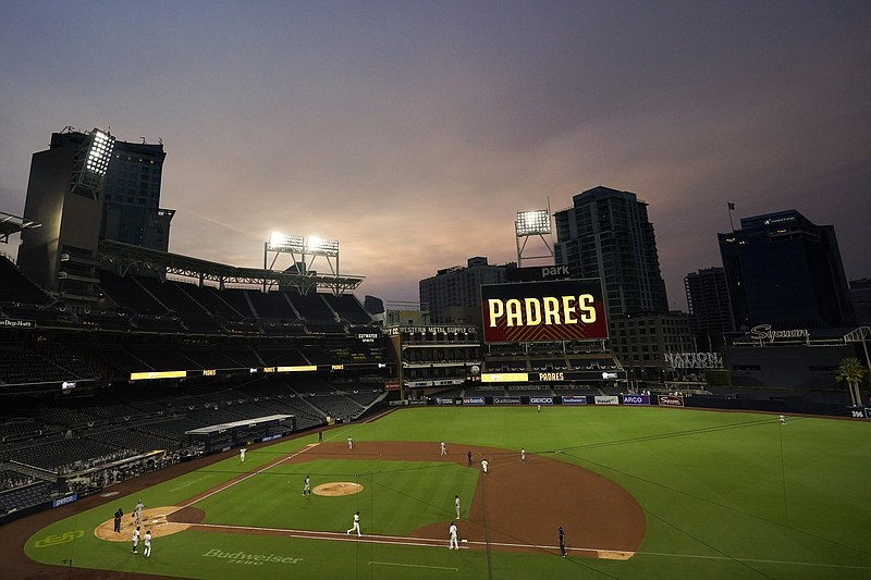 Smoke from California wildfires mixes with low clouds as the San Diego Padres...