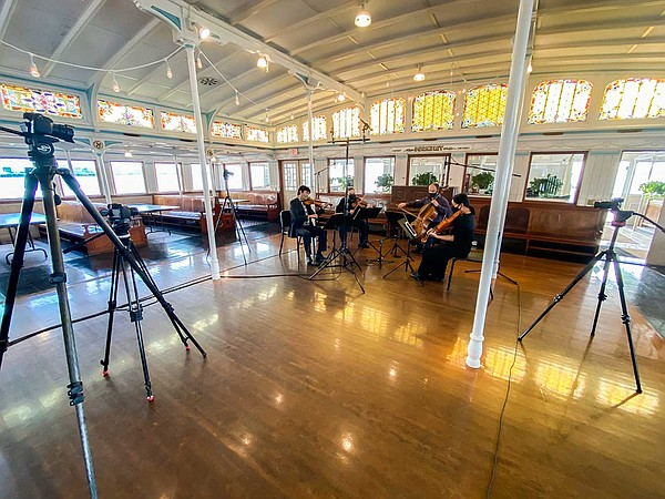 The Hausmann Quartet performs in an empty concert space a...