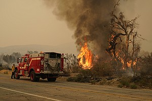 Photo for Southern California Wildfire Grows, Burns Nature Center