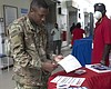 Army Pfc. Jerome Clunis, from the 94th Chaplain...