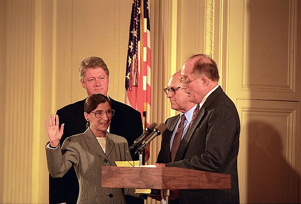 Chief Justice William Rehnquist swearing in Ginsburg as a...