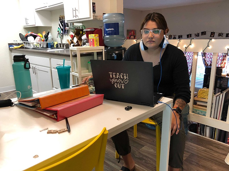 Leticia Avelar prepares to teach her virtual class from her home in El Cajon....