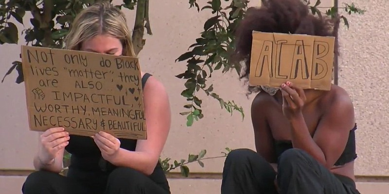 Two protesters at a protest downtown over the news of the indictment not char...