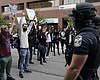 Protesters chant near police, Wednesday, Sept. ...