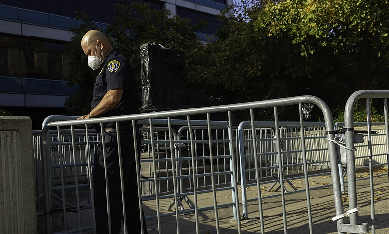Barricades line the entrance of the San Diego Police Department headquarter f...