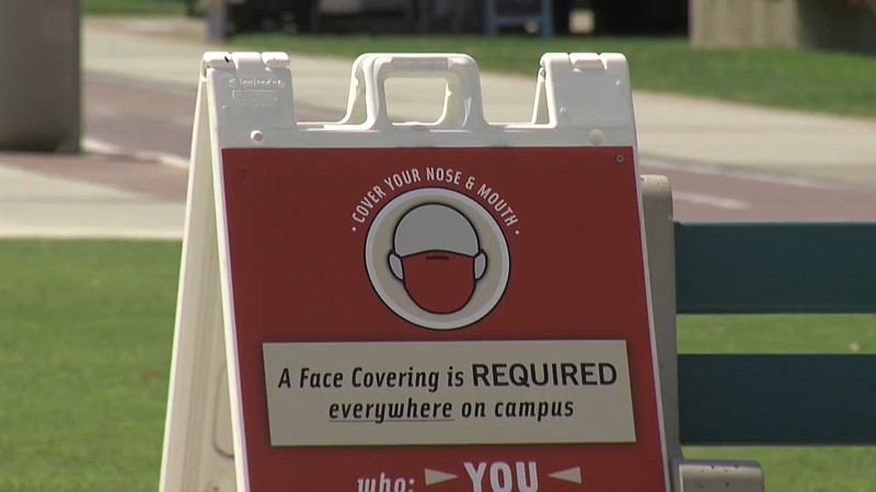 A sign at San Diego State campus telling people to mask up on campus in this ...