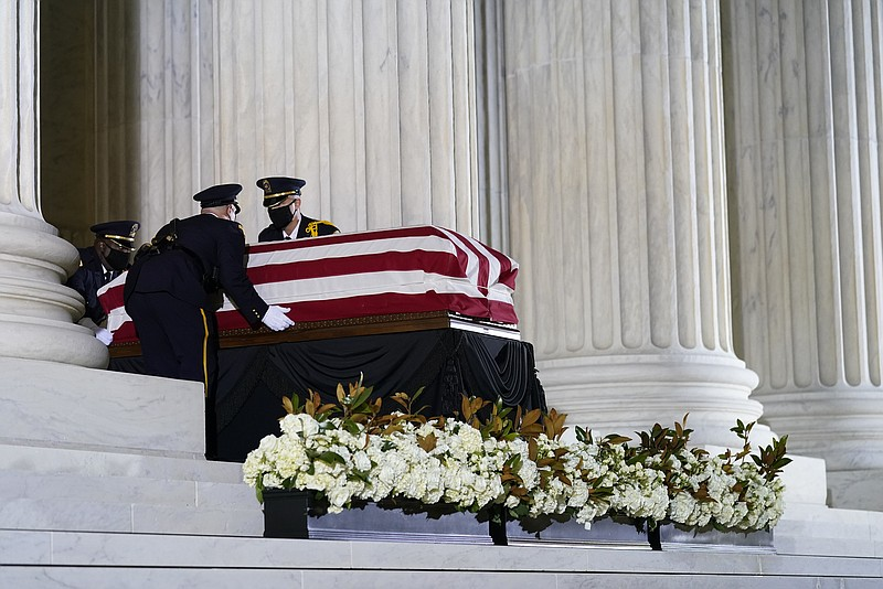 The flag-draped casket of Justice Ruth Bader Ginsburg arrives at the Supreme ...