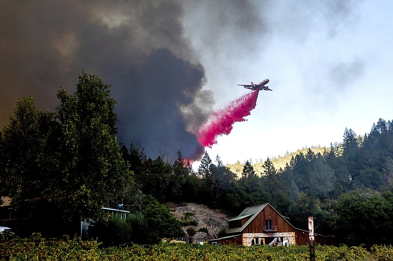 An air tanker drops retardant while battling the Glass Fire in St. Helena, Ca...