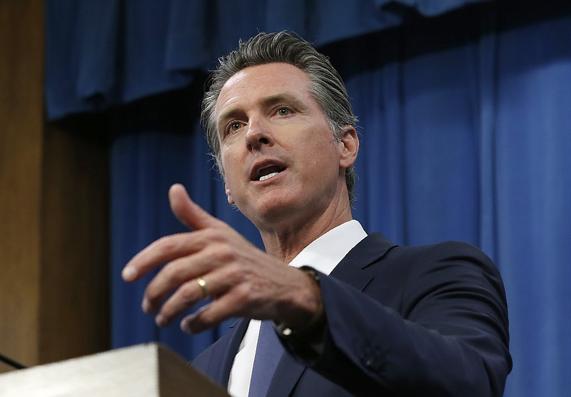 In this July 23, 2019, file photo, Gov. Gavin Newsom talks to reporters at hi...