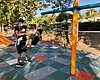 A family plays in a public playground in Poway,...