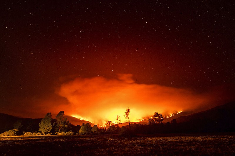 In this Sept. 16, 2020 file photo the August Complex Fire burns near Lake Pil...