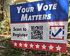 A register to vote sign is pictured in Golden H...