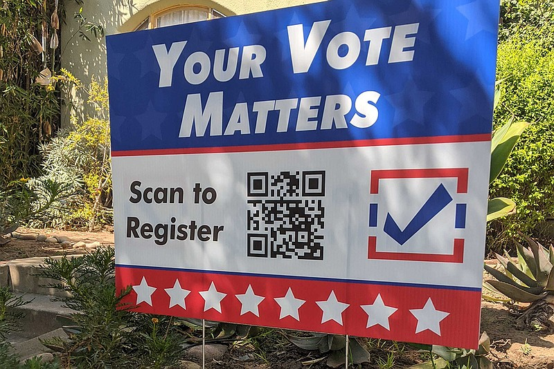 A register to vote sign is pictured in Golden Hill, San Diego, Sept. 22, 2020.