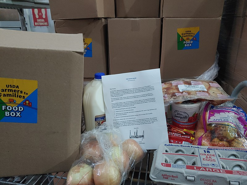 This undated photo shows food boxes that will head out to families in the San...