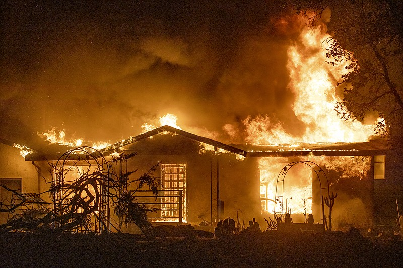 A house burns on Platina Road at the Zogg Fire near Ono, Calif. Sept. 27, 2020.