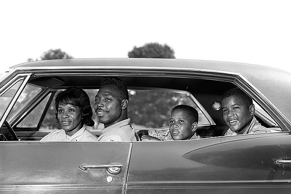 1960s, side view African American family - father, mother...