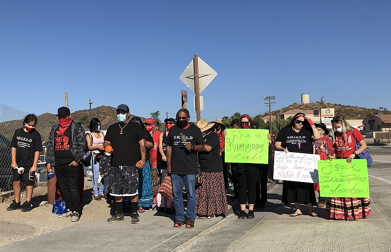 Members of the Kumeyaay Nation march to the Tecate port-of-entry to protest b...