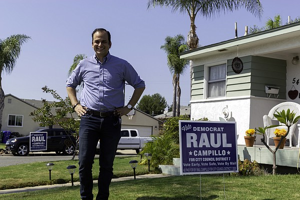City Council candidate Raul Campillo poses after deliveri...