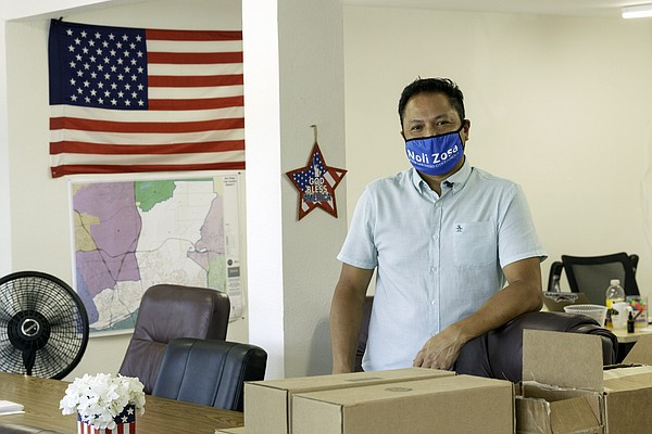 City Council candidate Noli Zosa poses in his campaign of...
