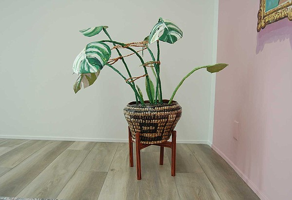 A plant sculpture is made entirely out of cardboard and c...