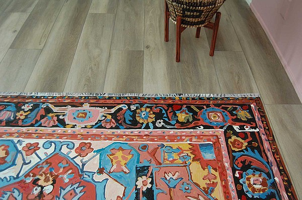 A canvas painted in the style of an elaborate rug is part...