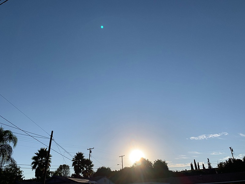 The sun rises of the San Carlos neighborhood in San Diego, Oct. 15, 2020.