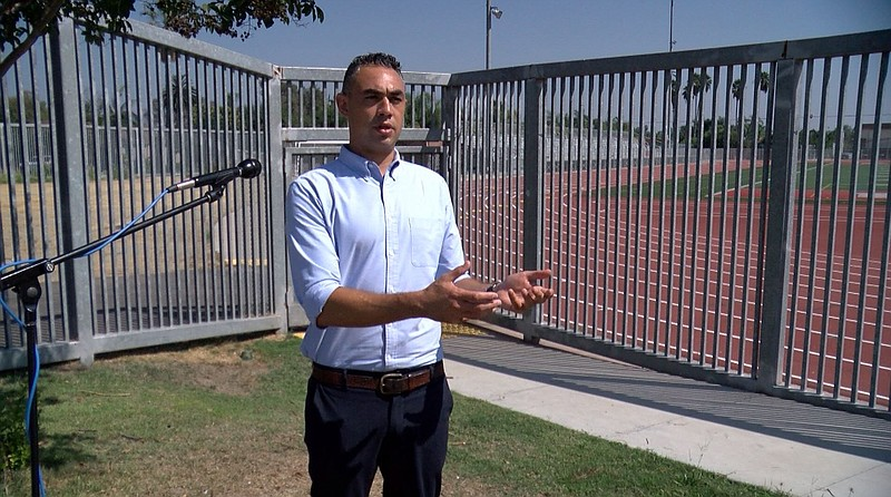 City Council District 9 Candidate Sean Elo-Rivera talks to KPBS outside of Ho...