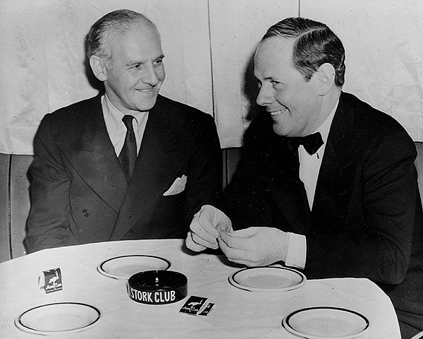 Walter Winchell sits with his good friend Sherman Billing...