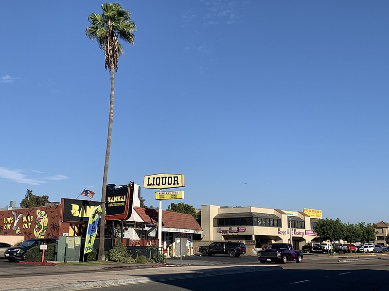 A liquor store and massage parlor are seen here in the Midway District, Oct. ...