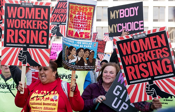 Women attend a protest in support of workers rights. (und...