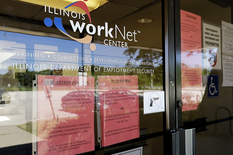 In this June 11, 2020, file photo, information signs are displayed at the clo...