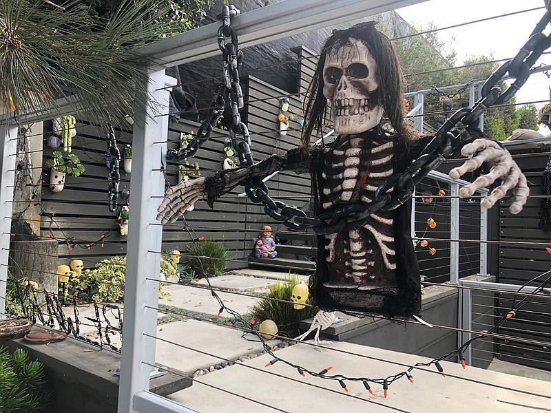 A skeleton Halloween decoration hangs on a fence in Leucadia, Oct. 24, 2020.