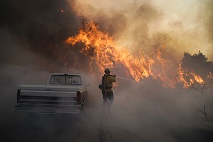 Photo for Wind A Major Risk As Orange County Fires Drive Thousands From Their Homes