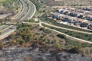 Photo for Evacuation Orders Lifted In 2 Orange County Wind-Driven Blazes