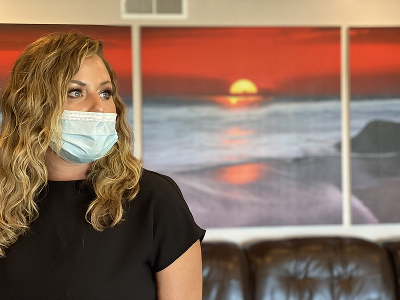 Brittany Goyette, a licensed ICU registered nurse, looks out the window of he...
