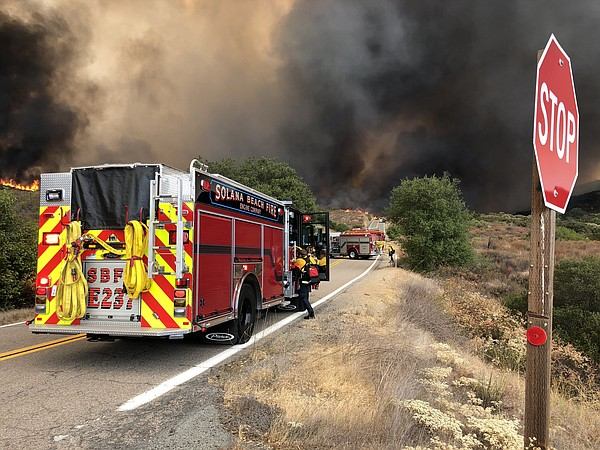 San Diego Firefighters battle the Valley Fire which scorc...