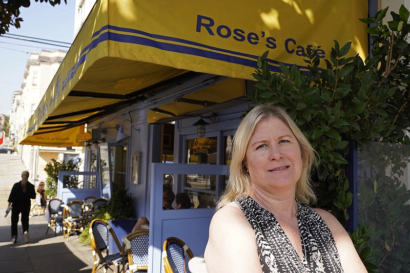 In this Sept. 28, 2020 file photo, Laurie Thomas poses outside of her Rose's...